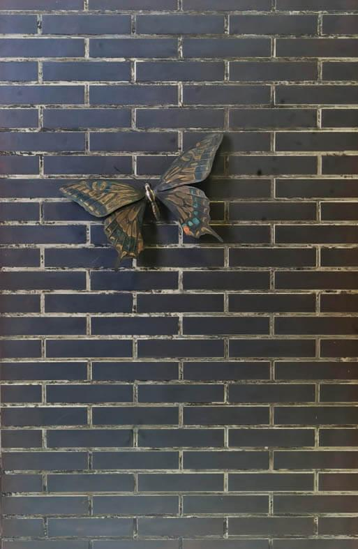 A tile and swallowtail butterfly